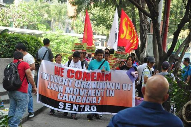 Sentro workers march in solidarity to the Royal Embassy of Cambodia in Makati