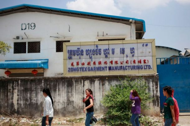 Workers walk past a closed Zongtex Garment factory near Veng Sreng Boulevard in Phnom Penh on Wednesday. Pha Lina
