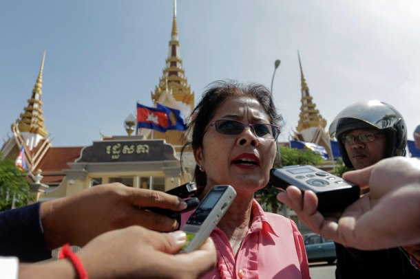 Lak Sopheap, an assistant to CNRP Vice President Kem Sokha, speaks to reporters outside the National Assembly in Phnom Penh on Tuesday, just hours after being ousted from the opposition party. (Siv Channa/The Cambodia Daily)