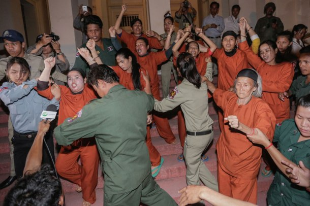 Anti-eviction activists shout as they leave the Appeal Court in Phnom Penh at the end of their hearing Thursday evening. (Siv Channa/The Cambodia Daily)