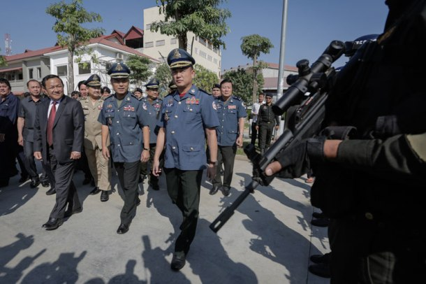 From left, Phnom Penh governor Pa Socheatvong, national military police Commander Sao Sokha and municipal Commander Rath Srieng arrive at the Phnom Penh military police headquarters for the municipal force's annual meeting Thursday afternoon. (Siv Channa/The Cambodia Daily)